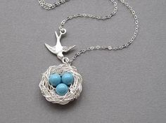 Bird nest necklace, sterling silver chain, flying bird, swarovski crystal pearl color choice, silver wire wrapped nest, three eggs