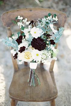 A bouquet of contrasting colors and snowberries for added texture | Brides.com