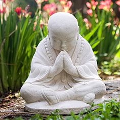 This detailed piece of garden decor portrays a child monk in meditation. This accent sculpture is crafted of white sandstone and will make a lovely ornament that is both durable and light.