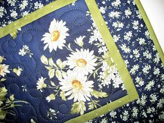Floral Table Runner, Daisy, Summer, fabric from Maywood, handmade Measures 14.25 x 48 inches Made by Chris I love the deep rich colors in this Daisy fabric from Maywood. It is beautiful with shades of cream, yellow/gold with variegated foliage on a gorgeous navy background. The