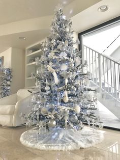 Flocked Christmas Tree with 5000k LED lighting. Silver, clear and white decorations. Modern, elegant tree by Rachel Pihakis of The Pathfinder Group Inc.
