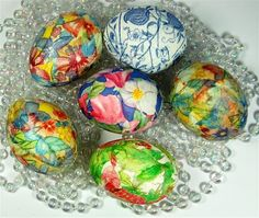 The blown out eggs are covered very simply by using some wallpaper paste and torn bits of gift tissue.