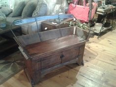 Bench made by WI farmer made from barn wood and the top of an old buggy