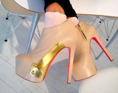 "Ruthie Davis wearing her @Ruthie_Davis ""Microcompact"" boots."
