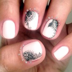 Neutral nails with black lace accents.