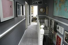 grey carpet. really not into beige. love the prints all the way down the stairs.
