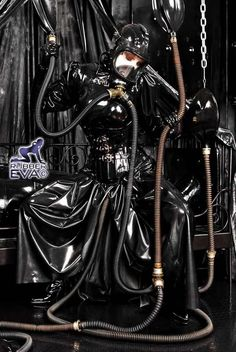 Woman wearing gas mask and play in latex
