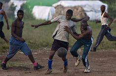 Men displaced by war play soccer at Bulengo camp just outside Goma in eastern Congo, February 26, 2009.