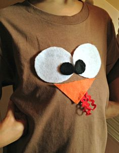 Kids will love looking like a turkey when you craft this DIY turkey t-shirt. This turkey t-shirt can be made using just $2 in supplies and under 30 minutes. The best part is, you don't even have to sew! Take a look below at how we crafted our own turkey t-shirt, perfect for Thanksgiving parties or just to get into the season of Thanksgiving in general!