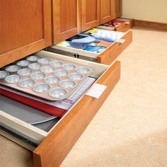 wonderfully organized kitchen! Use bottom of cupboards for less oft used items, muffin pans, pie plates, pans