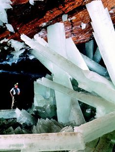 Giant Crystal Cave - A cave connected to the Naica Mine in Naica, Chihuahua, Mexico. Giant selenite crystals (gypsum), some of the largest natural crystals ever found. The maximum age is dated about 500,000 years. (See the little man at the bottom left!)