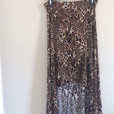 Cheetah Printed High-Low Skirt Stretchy, thin material, very comfortable, high-low cheetah printed skirt. Can fit anyone from small to large. I am a small and it fits well, my sister is a large and it fit her well too. Skirts High Low