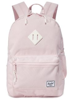 exclusive heritage backpack by Herschel Supply Co.. A pastel-pink Herschel Supply Co. backpack with a mesh side pocket. A two-way zip opens to reveal the lined, two-pock...