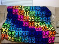 This cool blanket is made using the peace sign granny square,and there's a free pattern!!