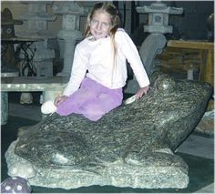 Stone Frog hand-crafted from granite in varying sizes. Take a look at http://www.stonestatuestore.com/natural-stone-granite-animals