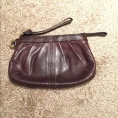 Coach brown leather wristlet Hang tag, zip closure, interior pocket. Perfect condition - no signs of wear, stains, etc.! Cute, checkered interior (picture included)! Coach Bags Clutches & Wristlets