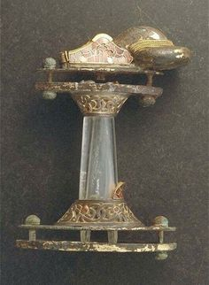 Sword hilt of gilt-bronze, gold and silver with inlaid garnets from Vallstenarum, Gotland, ca. 600