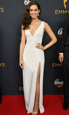EMMY ROSSUM dons a sleek white Wes Gordon gown with Brian Atwood heels and Fred Leighton jewelery.