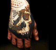 Hand tattoo by Nikko Hurtado