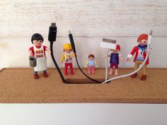 Use your figures to hold your device wires.