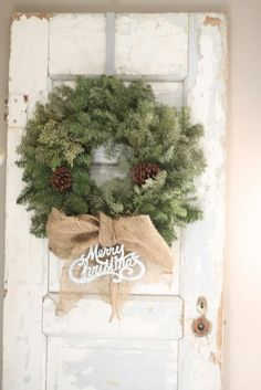 Simple Christmas wreath with burlap bow. Love the chippy vintage door Merry Little Christmas, Country Christmas, Simple Christmas, All Things Christmas, Winter Christmas, Christmas Wreaths, Christmas Decorations, Christmas Items, Christmas Design