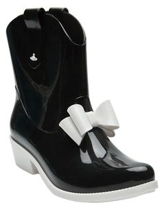 Protection pointy boot in black with white from Vivienne Westwood Anglomania   Melissa. This pvc western-style rain boot features a pointy toe, front bow, double pull-up straps, with contrast white sole and heel. Heel measures 1.75