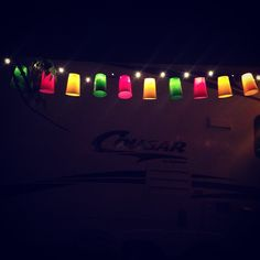 DIY camper lights! Cut Xs in solo cups. Push Christmas lights through!