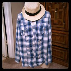 Playful plaid Super cute plaid button down short. The buttons snap and can be worn as a lot going sleeve or rolled up with snaps as well. It has ripples down the front of the shirt to give a flattering appearance. Cato Tops Button Down Shirts