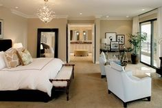 Bedroom.  Simply elegant yet also masculine.  Love the bench at end of bed.  Color scheme is also nice