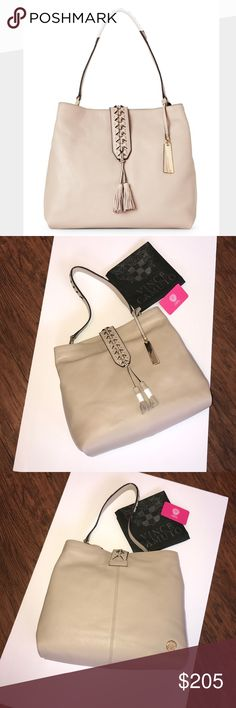 "VINCE CAMUTO Ancel Hobo Almond Beige Guaranteed Authentic! Vince Camuto Ancel hobo. Color: Almond beige with gold tone hardware. Dust bag included. Genuine pebbled leather exterior, magnetic flap-strap closure, single handle, metal rings and triangular cutout detailing, tassel accent.  Interior features fabric lining, 1 zip pocket , 2 slip pockets, and 1 zip pocket in the middle separating interior in two separate compartments. Measurements: 13""L x 11""H x 5""W. Item will be videotaped prior…"
