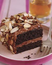 Toffee Almond Crunch Cake Recipe on Food & Wine With its layers of tender chocolate cake and chocolaty sour cream frosting, this dessert on its own is completely spectacular. But Patti Dellamonica-Bauler, the pastry chef at One Market in San Francisco, takes it one step further by covering it in toasted almonds and crushed toffee candy.