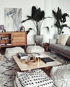 Lounge room living modern boho greenery plants ottoman floor cushions rug coffee table