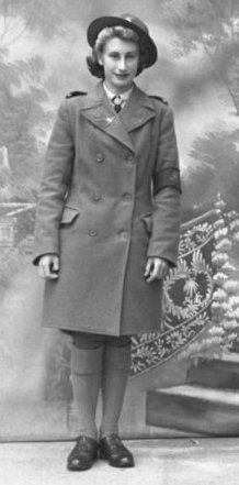 Women's Land Army   My Mother, Miss Rita M Thompson Age 18, 1942;   Land Girl in greatcoat.  Thanks to PINTEREST I found this photo of my Mother!