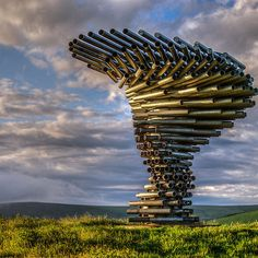 Dawn at the Singing Ringing Tree, 2006, part of four sculptures... a regeneration project created by the East Lancashire Environmental Arts Network...landmarks across East Lancashire to symbolize the re-birth of the area.  Designed by architects Mike Tonkin and Anna Liu of Tonkin Liu, it is a 3 metre tall construction of galvanized steel pipes which harness the energy of the wind to produce sounds covering several octaves.