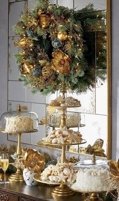 Gold-kissed magnolia blooms and berries add an opulent layer to a bed of lifelike cypress and pine. Beautifully painted glass ornaments and 100 warm white LED lights amplify the dramatic elegance of this gilded accent. Each element is carefully handcrafted and placed for exceptional realism and maximum density, year after year.