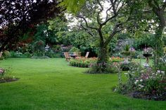 This yard is very open with plenty of space. The perimeter of this beautiful landscaping is full of bright flowers and plants.