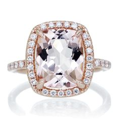 Morganite ring in 18k rose gold with 3.50 carat total weight. This beautiful Morganite engagement ring set is crafted in solid gold, adorned with dazzling white natural diamonds. Carefully selected, diamonds are set in a halo, as well as half way down the shank of this engagement ring. And what's ma
