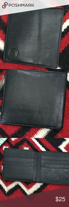 SOFT black leather billfold Soft as baby skin vintage wallet with Insignia outside and name inside, cannot decipher- Pierre Cardin?, you try! Four inside slots, one dollar slot. Good condition 8:10 Pierre Cardin Bags Wallets