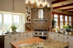 Farmhouse kitchen with corner range and hood [Design: Smith & Robertson]