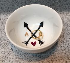 A personal favorite from my Etsy shop https://www.etsy.com/listing/229446176/jewleryring-dish-personalized-arrows