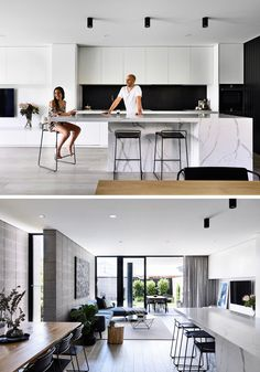 Kitchen Interior In this kitchen, a black backsplash ties in with the black timber, while minimalist, hardware free white cabinets and a stone island with seating complete the modern look.