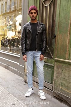 Leather Threads   Wear a leather biker jacket over a black sweatshirt. Add some light wash denim jeans and a pair of white trainers. Complete the fit with a burgundy beanie and jewellery to style.   Shop men's clothing at The Idle Man