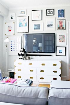 Gallery wall around a TV. Love this Idea it makes the TV blend in