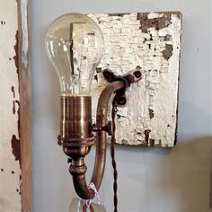 Chippy Gooseneck Sconce  Created from Architectural Salvage. $79.00, via Etsy.