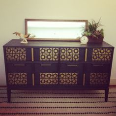 """Mid Century Modern dresser painted in Graphite Chalk Paint® and Royal Design Studios """"Hollywood Squares"""" stencil using a mixture of Bright Gold and Antique Gold Stencil Creme. Sealed with Annie Sloan clear wax."""