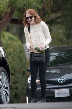 Sweater weather: With a green juice at the ready, the smiling star combated the unusually grey LA weather with a snugly ensemble