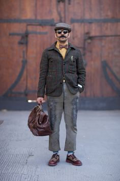 Vintage-inspired tailoring in the pre-war spirit of the suit as the everyday workwear uniform, feeling artisanal and premium today especially with the beautiful leather bag and footwear. WGSN street style at Pitti Uomo Subscribersclick herefor trends and full images galleries!