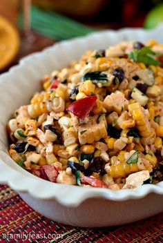 Mexican Corn Salad ~ This Salad is Chock Full of Corn, Zucchini, Peppers, and Beans, all Tossed Together with Cheese in a Flavorful, Light and Zesty Dressing.
