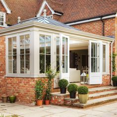 Garden room exterior Sympathetically designed to complement the traditional exterior of the home, this Orangery extension was carefully matched to the existing brickwork of the property, helping to retain its original character. Orangery Conservatory, Conservatory Dining Room, Conservatory Design, Orangery Extension Kitchen, Cottage Extension, Conservatory Extension, Garden Room Extensions, House Extensions, Contemporary Garden Rooms