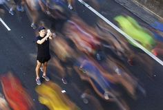 "A man takes a picture of himself among participants during the annual ""City2Surf"" fun run in central... - REUTERS/Daniel Munoz"